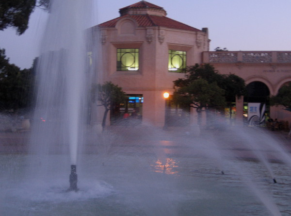 The nearby fountain takes on a beautiful glow as night descends.