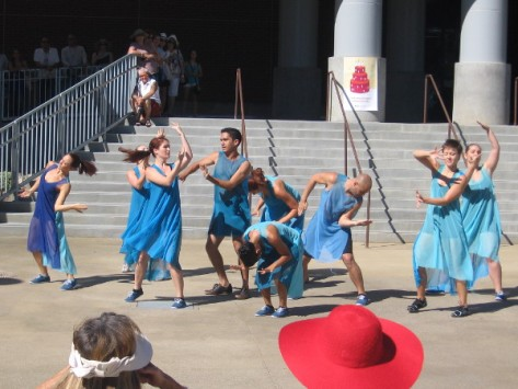 Rhythmic energy fills the unusual stage on a sunny, quite warm day.