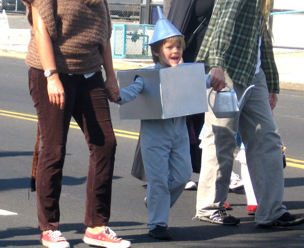 Boy dressed as tin man enjoys Boulevard BOO! Parade in San Diego.