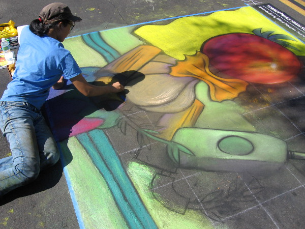 Torrey Pines High School National Art Honor Society student works on asphalt canvas.