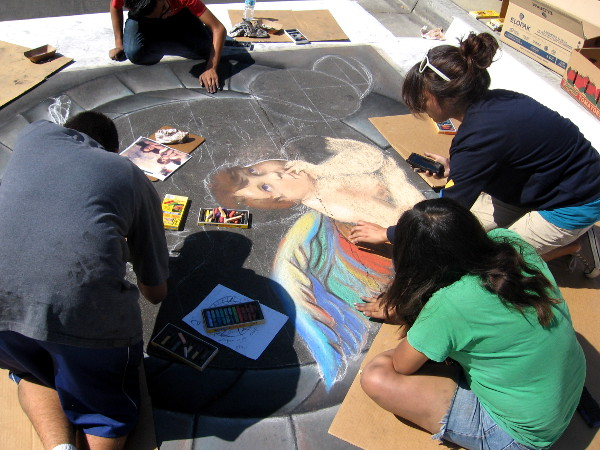Very talented young people are hard at work on a sunny day in San Diego.