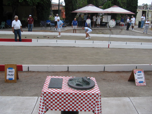 Two bocce courts are open to the public in Amici Park near sculptures of Italian food!