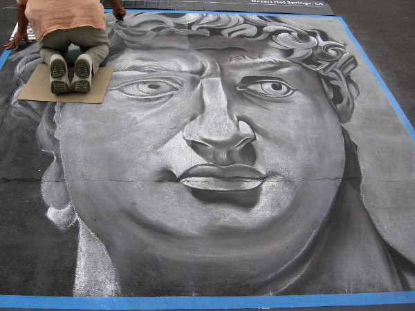 Bijan Masoumpanah chalk art shows face of classic Roman statue.