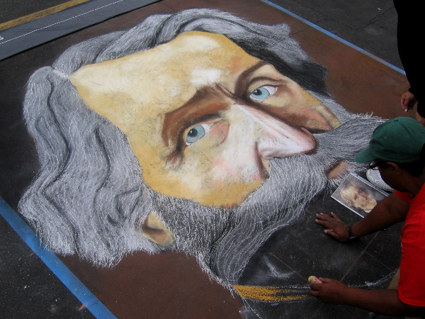 Shawnet Sweets chalk art depicts a colorful, whiskered person.