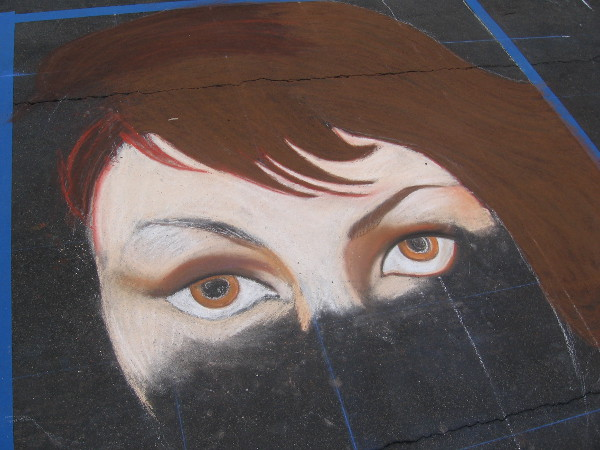 Team Parada chalk art eyes appear on a downtown San Diego street.