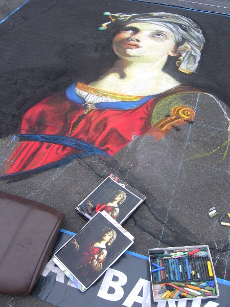 Lauren Minadeo is working on a chalk art portrait.