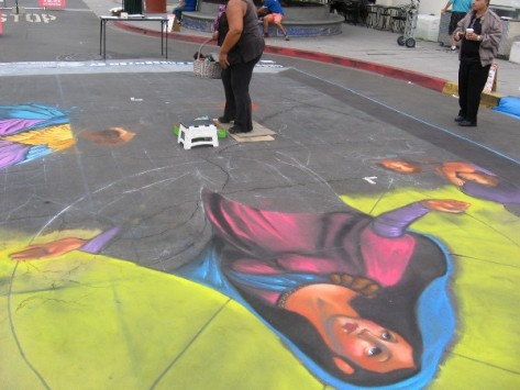 Cecelia is well underway creating the amazing 20 by 30 foot chalk image.