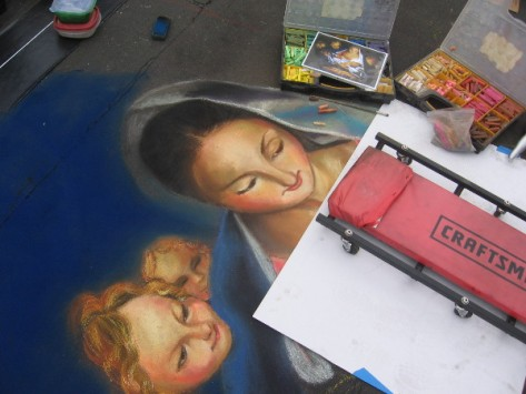 Tonie Garza chalk art of several tender, beautiful faces.