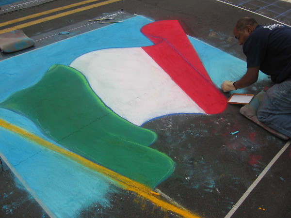 Byron Houston weaves a windblown flag of Italy with a small stick of chalk.
