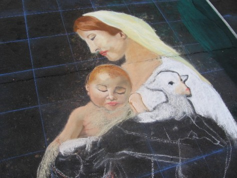 Kira Lewis-Martinez chalk art of a classic Nativity scene.
