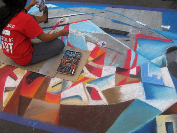Team Noni produces unusual abstract chalk art showing biplanes over a cityscape.