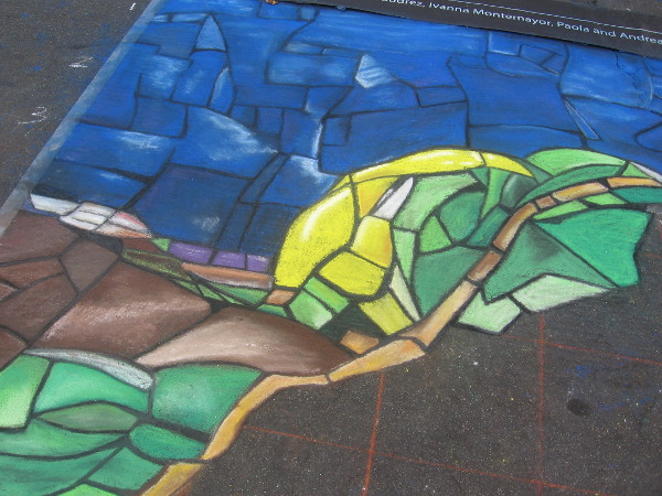 United Souls is creating a colorful chalk mosaic that looks like stained glass.