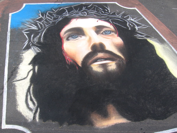 Team Pinoy chalk art shows face of Jesus on a bible.