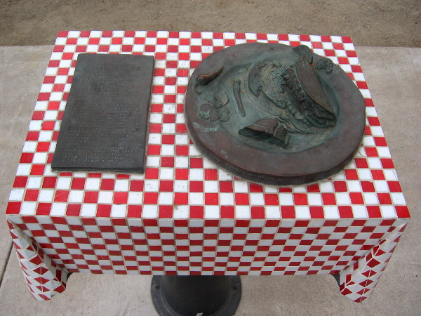 Metal sculpture of blackened fish taco plate in Little Italy's unique Amici Park.