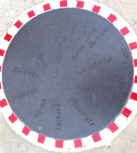 Round plaque at Amici Park shows many popular spices.