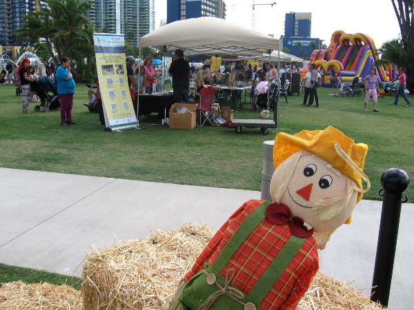 Scarecrow and hay bales at pumpkin patch in San Diego's new waterfront park.