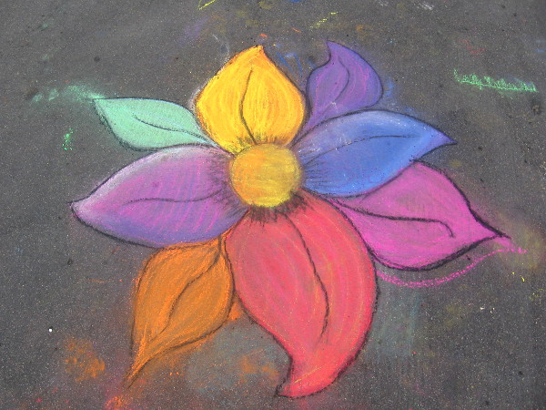 Just a flower someone drew on the asphalt for no reason other than pure joy.