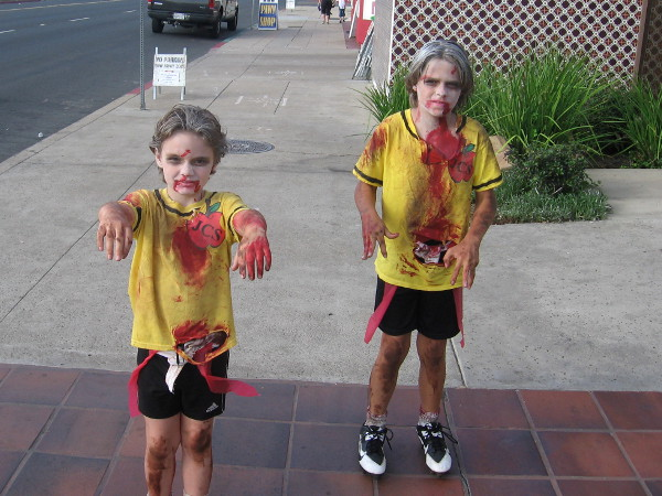 Two scary zombie kids were seen lurching down the street before the parade began.