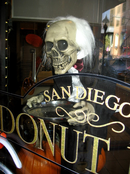 Donut Bar window contains a scary skull-headed server!