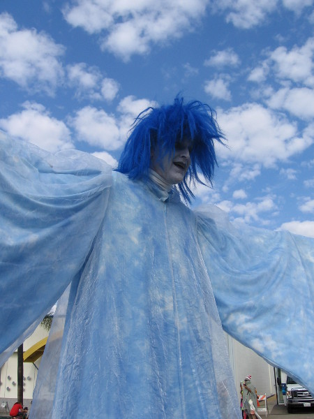 Super tall Boo is blue, and he seems to blend in with the clouds.