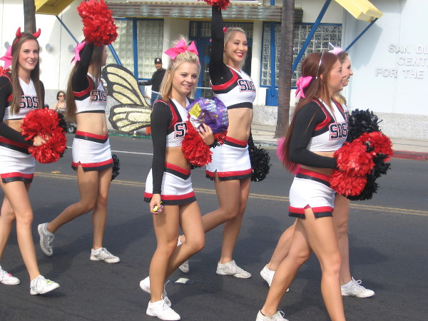 Here come some smiling SDSU cheerleaders.
