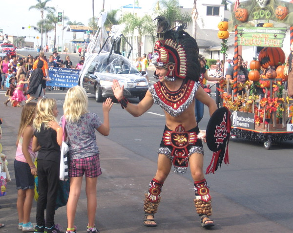 The San Diego State University mascot Aztec Warrior gives a high five!