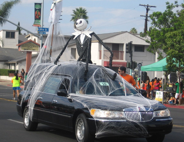 Lots of cars in the parade were draped with creepy cobwebs.