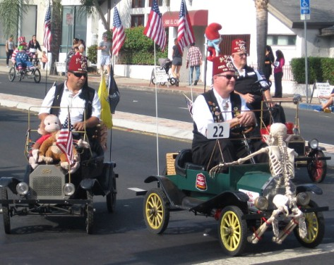 Here come the Shriners in their Halloween-themed mini-cars!