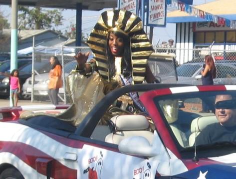 A beauty queen is wearing a big, golden pharaoh headdress!