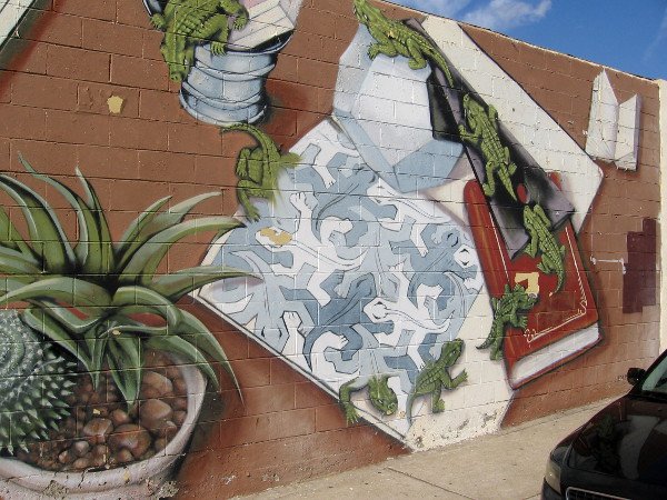 Lizards undergo transformations in a very creative street mural in San Diego.