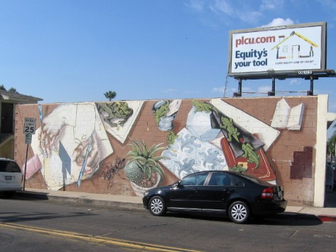 Colorful images on a building at 56th and El Cajon Boulevard in San Diego.