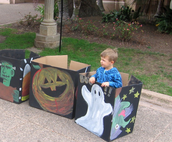 Boy emerges from a magical boo-box!