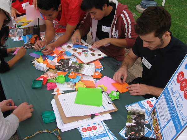Guys creating origami courtesy of the Japanese Friendship Garden.