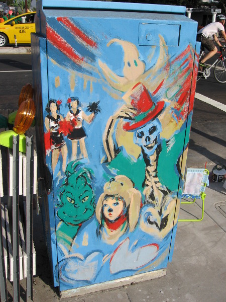 Utility box on El Cajon Boulevard painted with scenes from BOO! Parade.