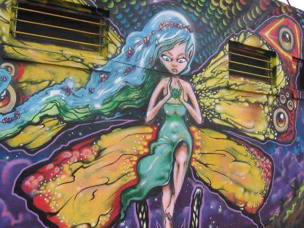 Super cool mural in University Heights has colorful butterfly lady as centerpiece.