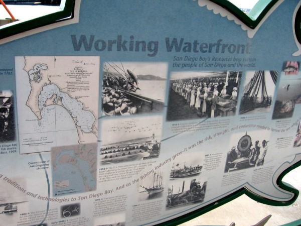 Working Waterfront sign shows photographs from San Diego's rich fishing history.
