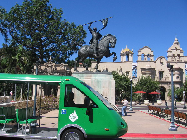 Balboa Park's free shuttle passes the El Cid statue on a sunny day.