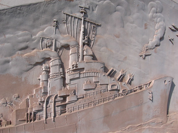 Close look at artwork of naval engagement on USS San Diego Memorial.