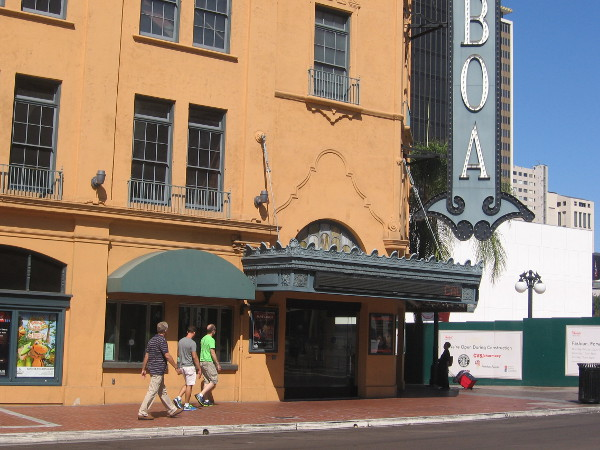 People walk past box office of the historic Balboa Theatre.