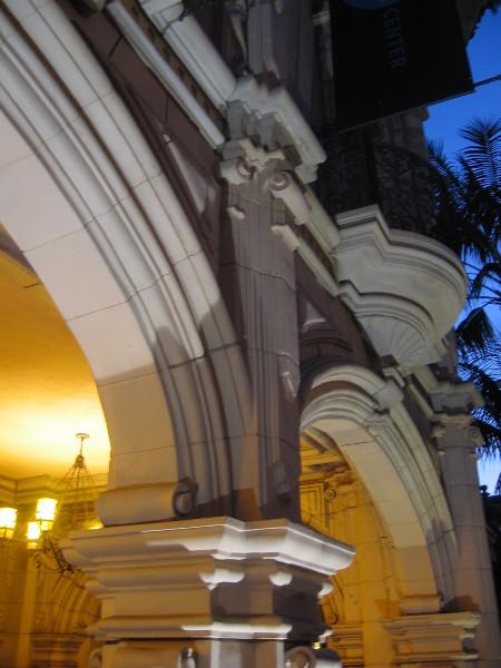 Ornate building facades on El Prado take on new depth at dusk.