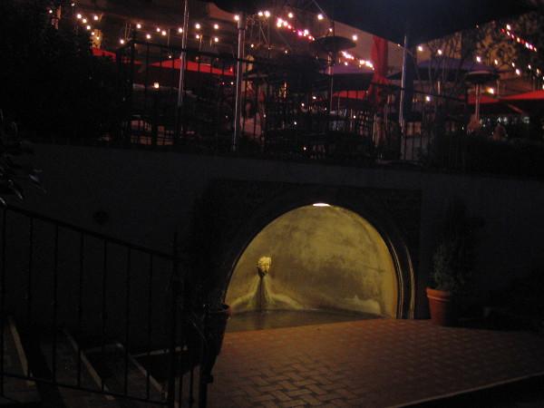 Illuminated fountain beside patio beneath The Prado restaurant in Balboa Park.