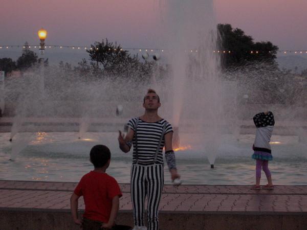 One last juggle by darkening fountain near Reuben H. Fleet Science Center.