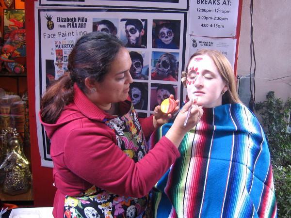 Young lady has face painted to celebrate Día de los Muertos.