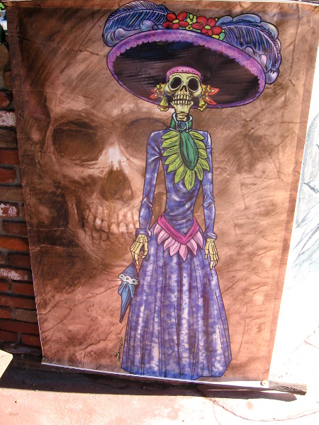 Image of woman skeleton in old-fashioned purple hat and dress.