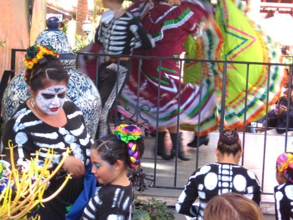 Folk dancers on and off stage at Fiesta de Reyes during Día de los Muertos.