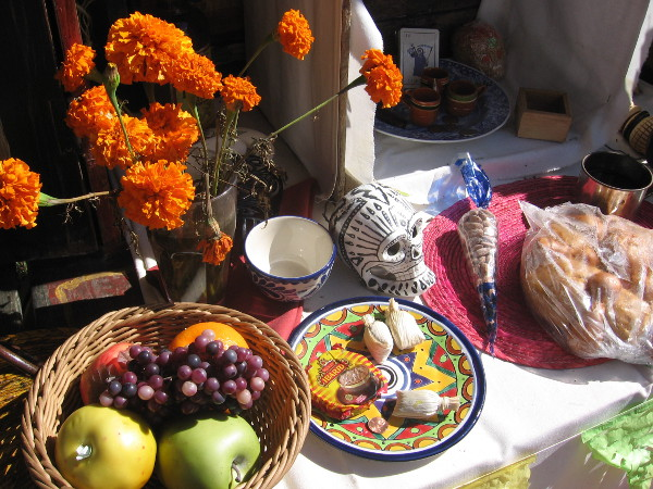 Altars often contain food liked by the deceased, to entice their spirits.