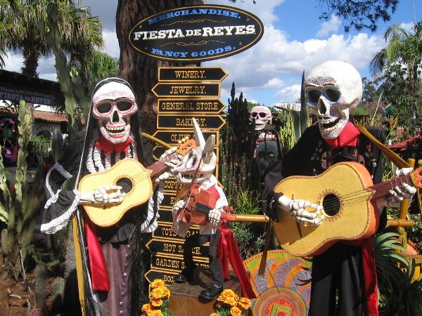 Mariachi skeletons strum guitars at entrance to Fiesta de Reyes.