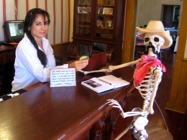 Bartender offers drink to skeleton cowboy at the Cosmopolitan Hotel's bar!