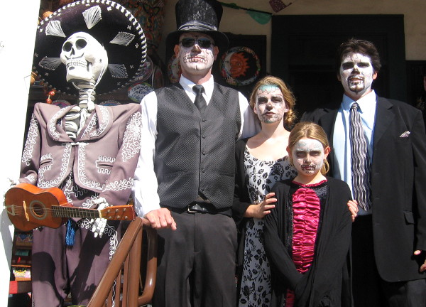 This well-dressed family all had their faces painted to resemble skulls!