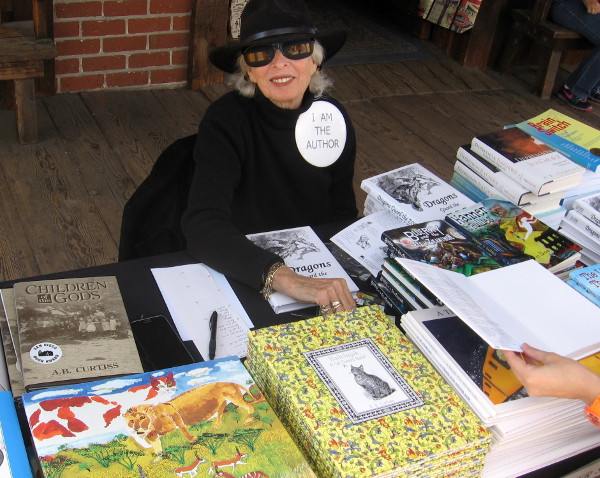 Author A. B. Curtiss was signing her acclaimed books at Día de los Muertos.